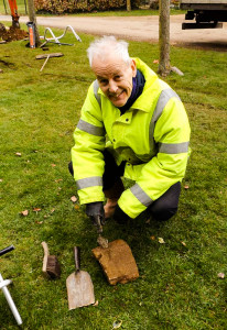 Jonathan Hunn inspects an architectural fragment found in the cable trench