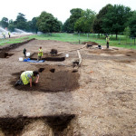 Picture showing 3 people working on excavation site of roman remains